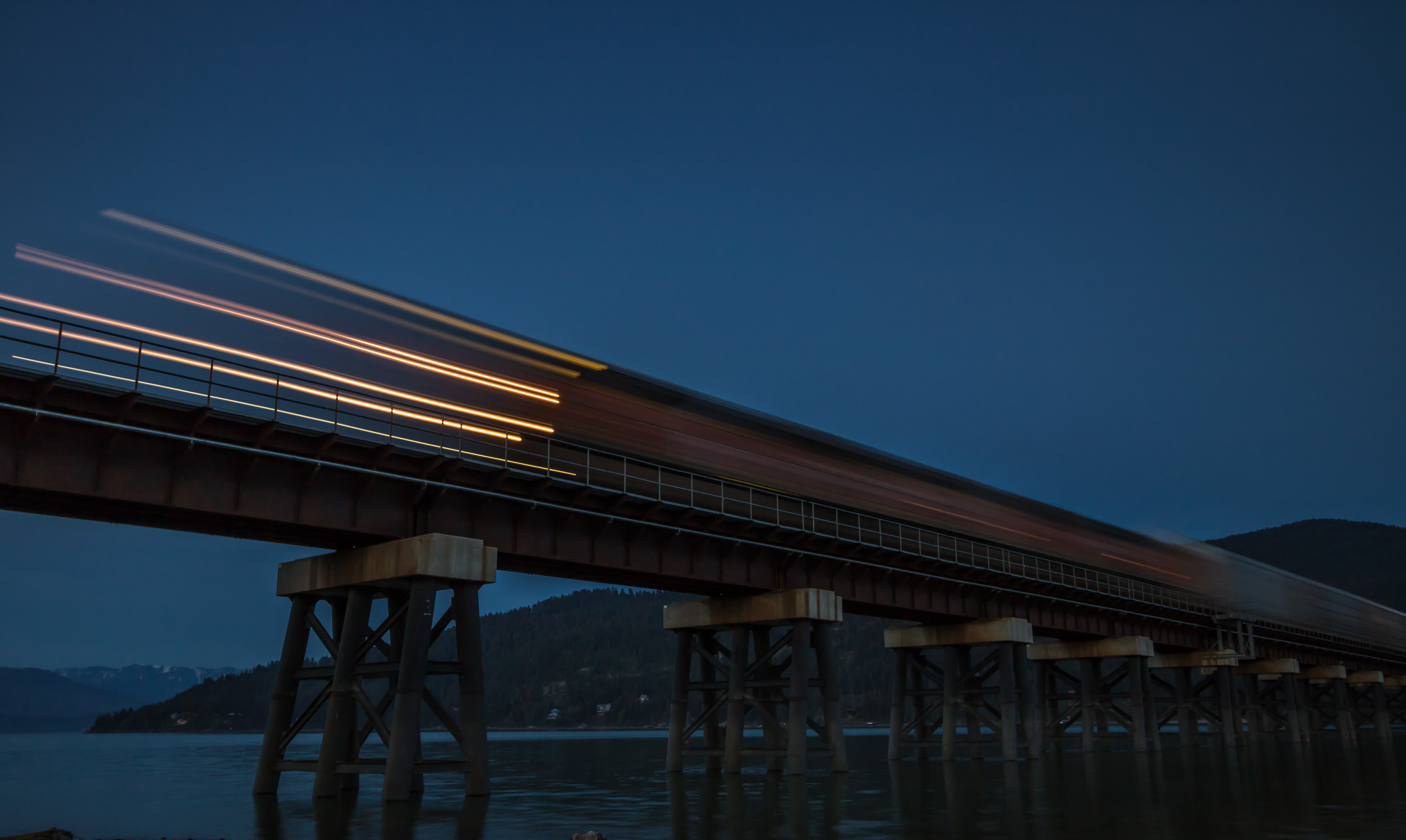 timelapse photo of train at nighttime