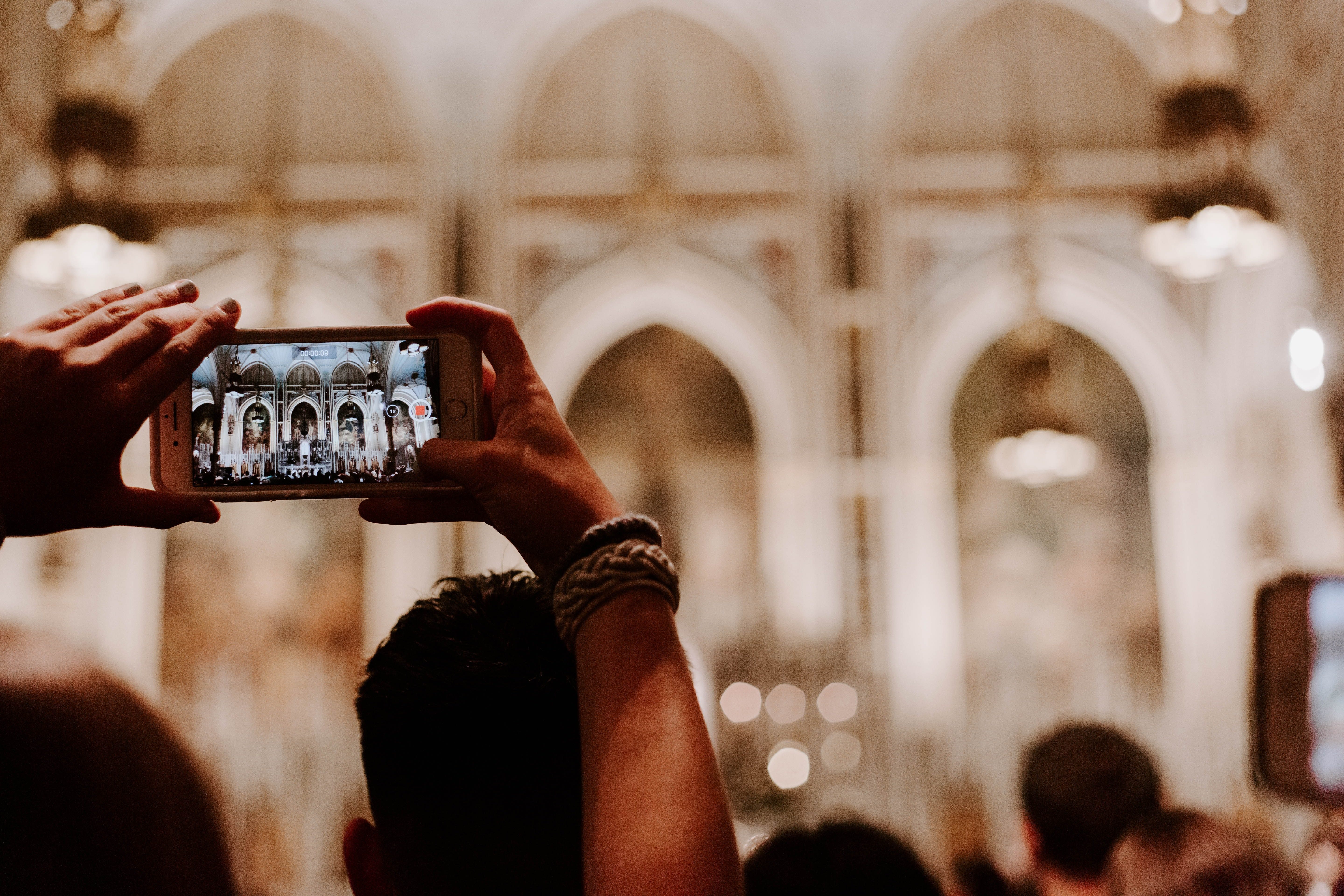 person taking a photo of cathedral
