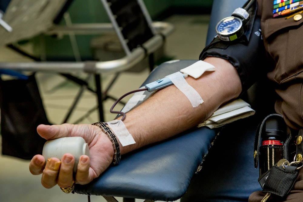 person on chair donating blood