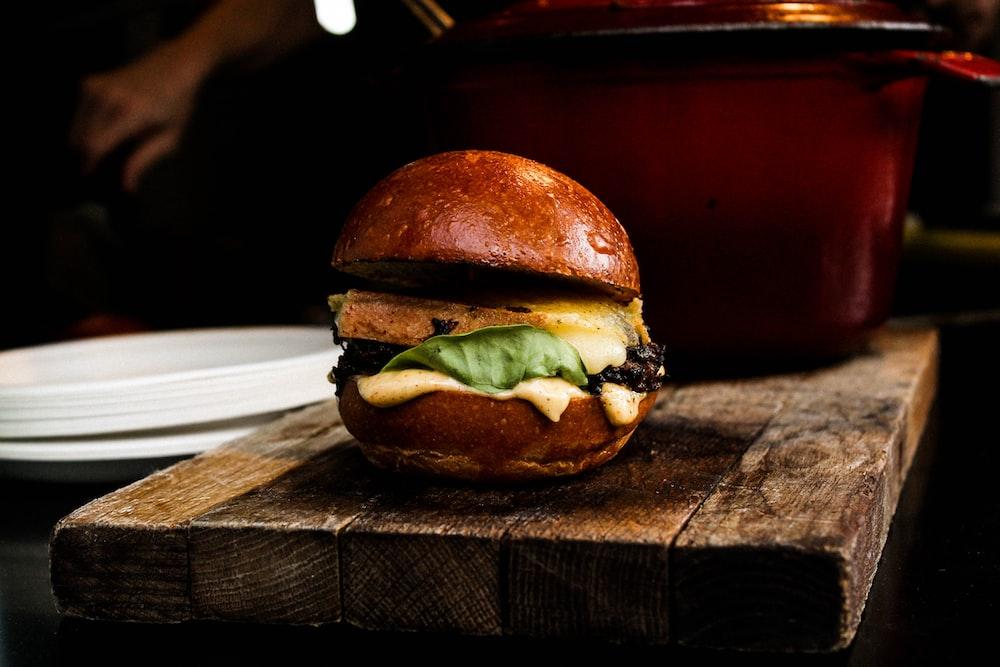 burger on top of brown board