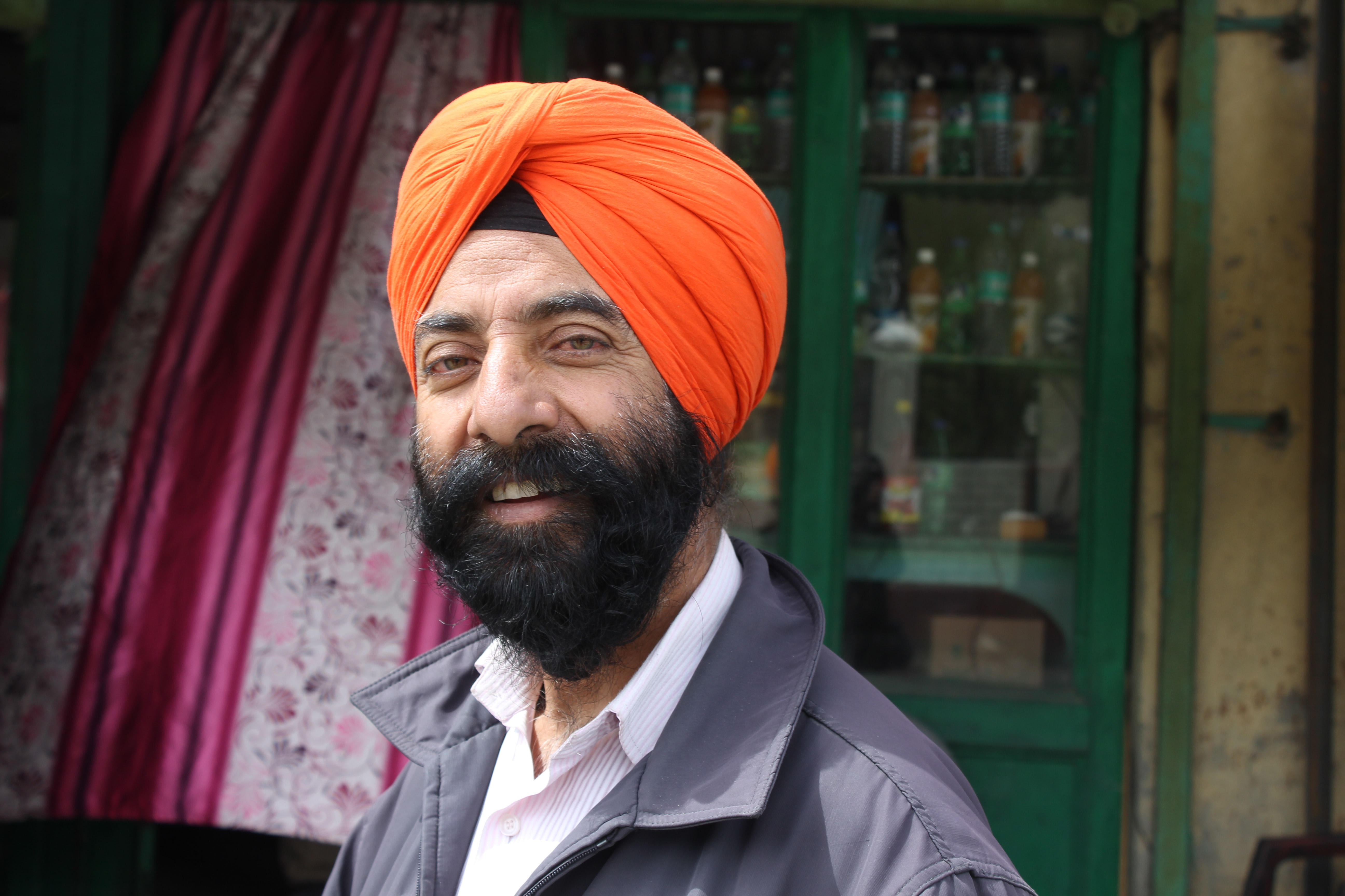 man wearing orange turban
