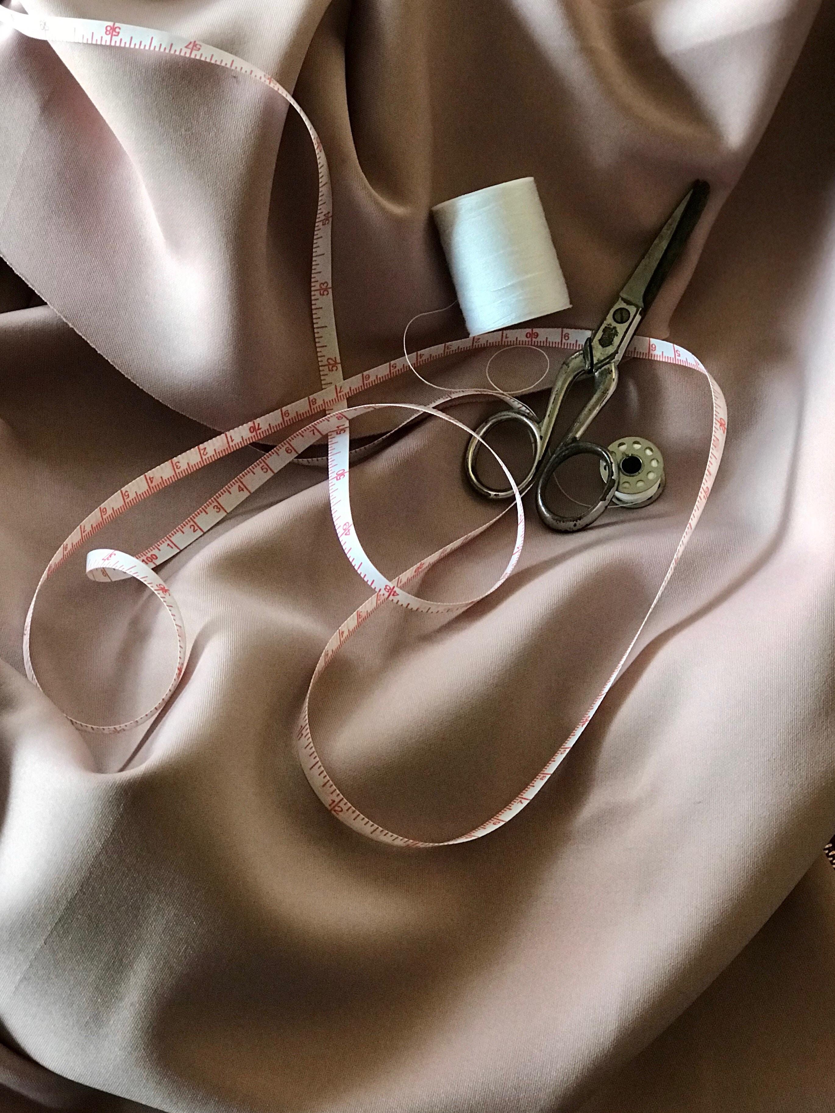 white tape measure and gray scissors