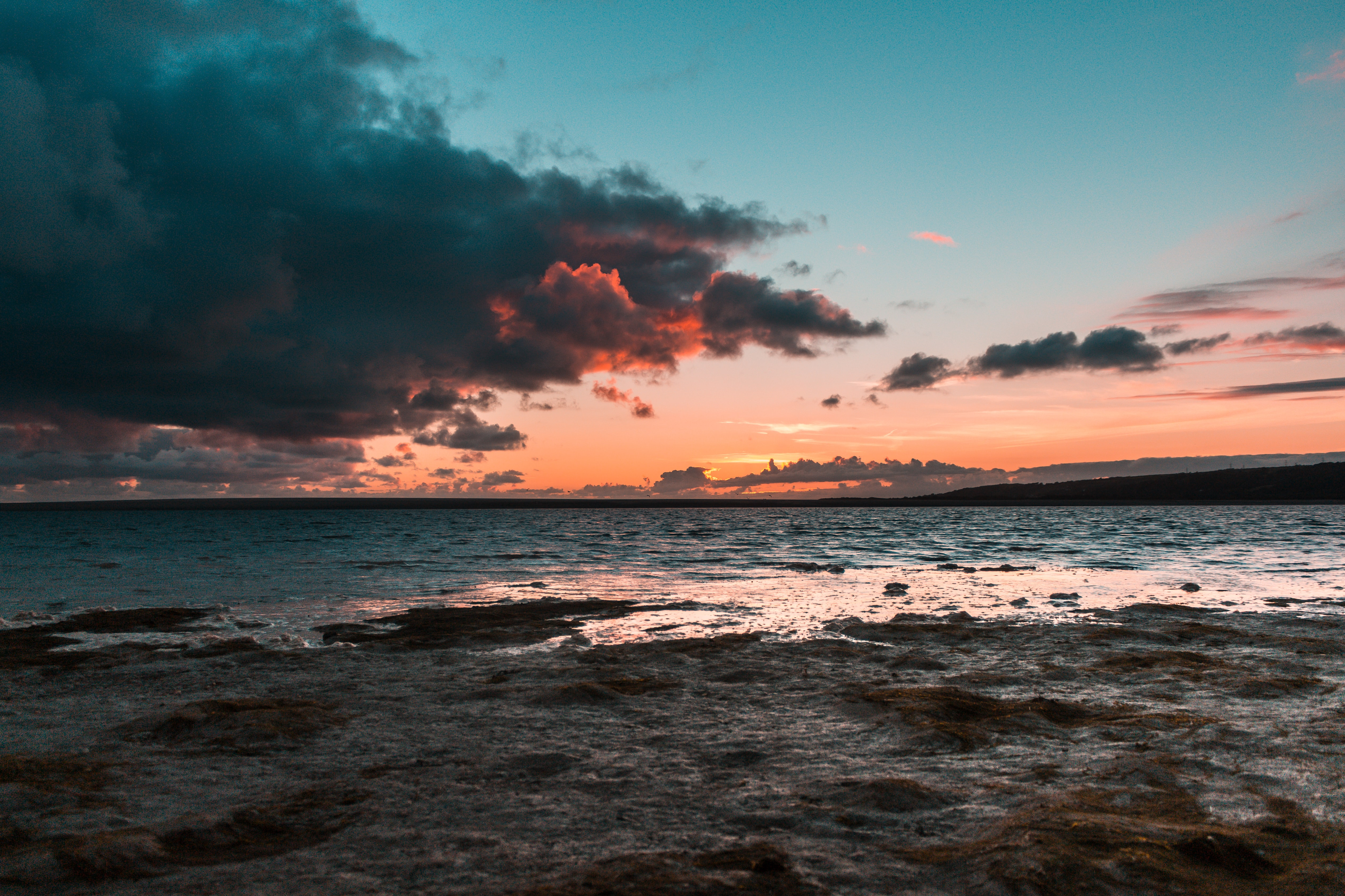seashore under dark sky