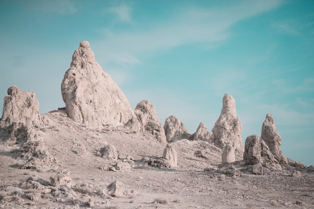 gray and black rock formations under blue and white sky during daytime