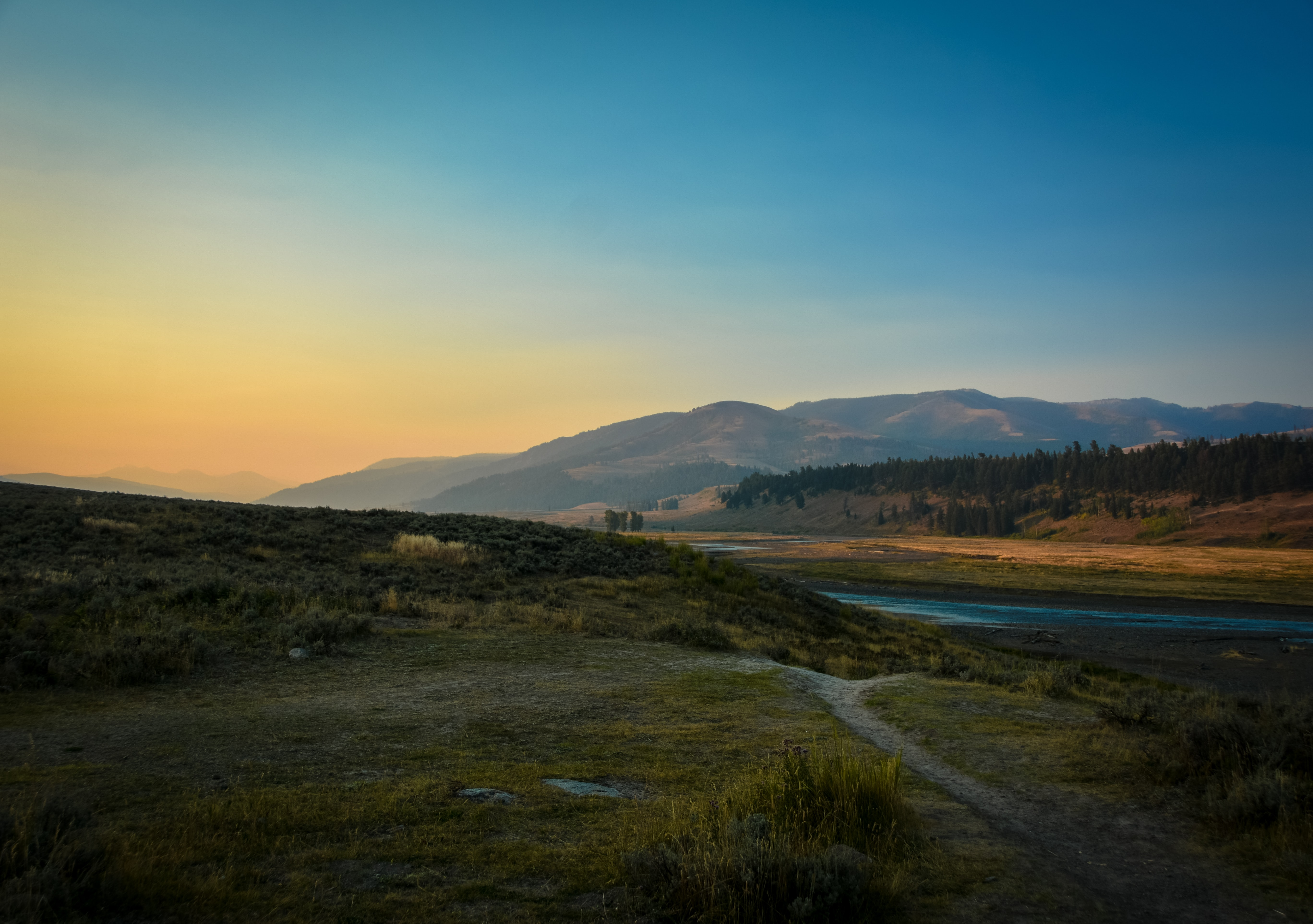 landscape photography of river and mountain