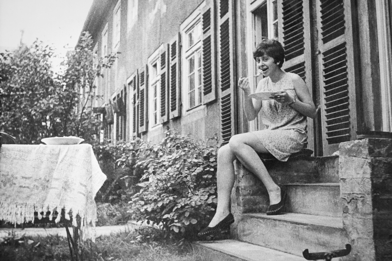 woman sitting beside door