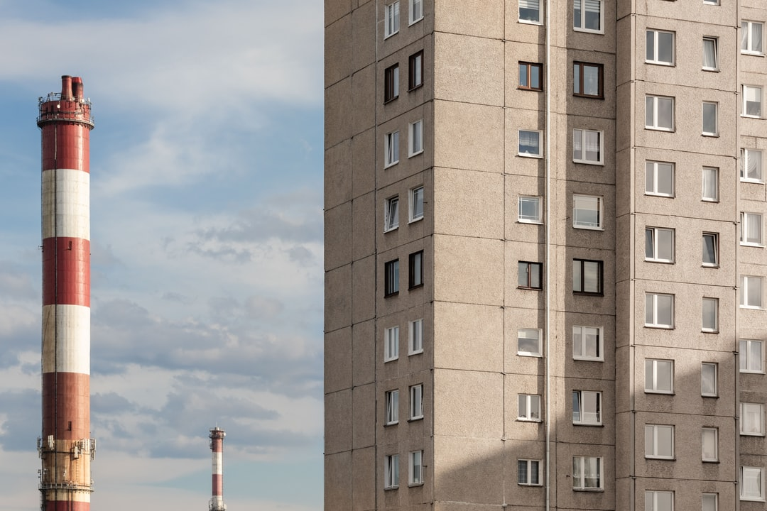 """I've uploaded some photos of Polish blocks of flats. This one is an example of one that hasn't received this """"love"""" of painting in colorful patterns. The dirty chimney seems more joyous ;)"""