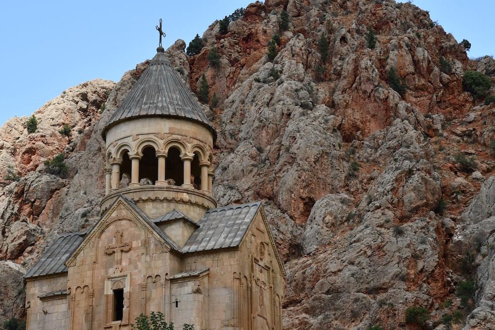 beige chapel near mountain