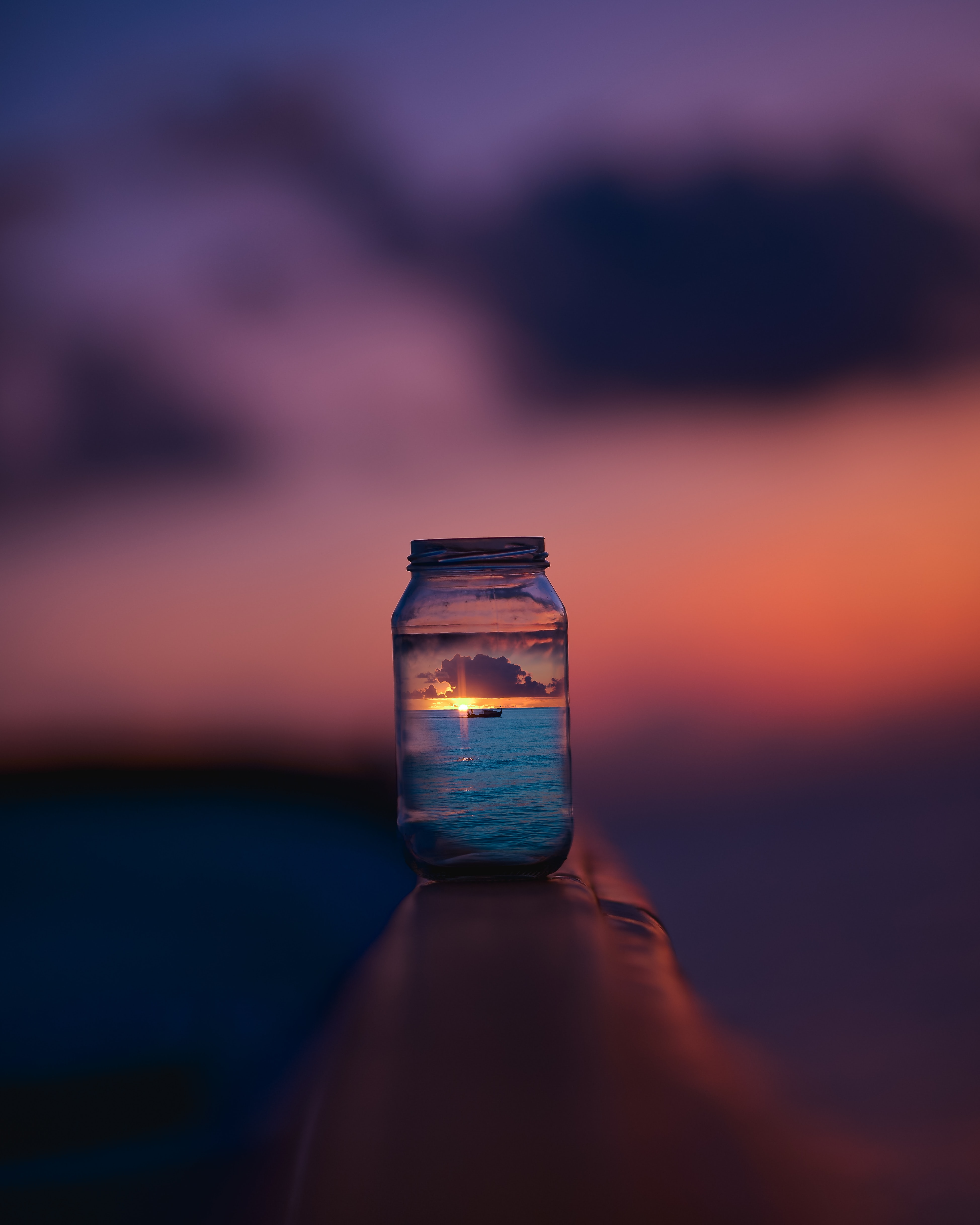 view of sunset on glass jar