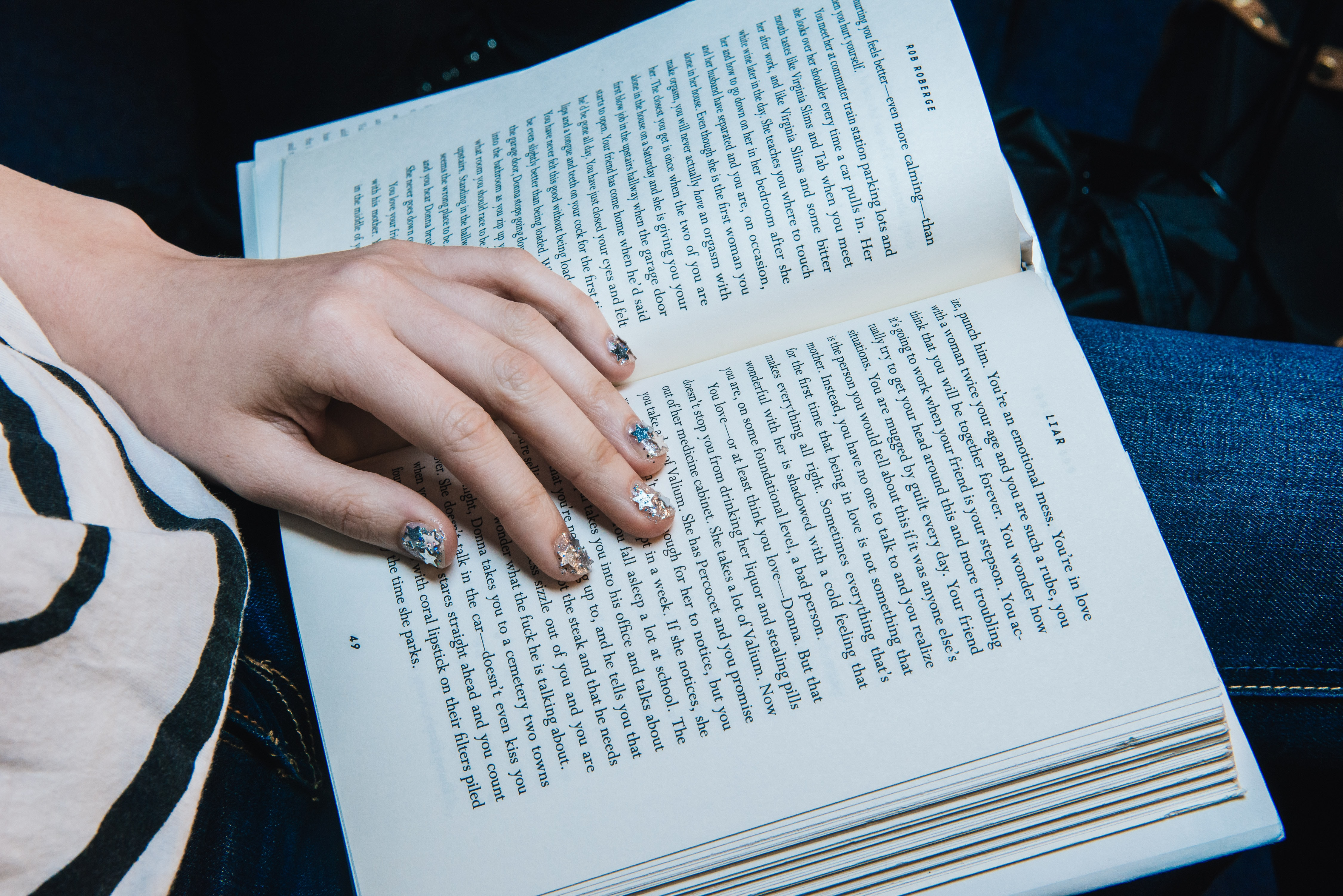 person reading on opened book