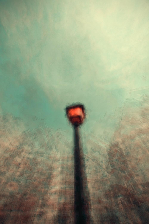 black street lamp on green grass field