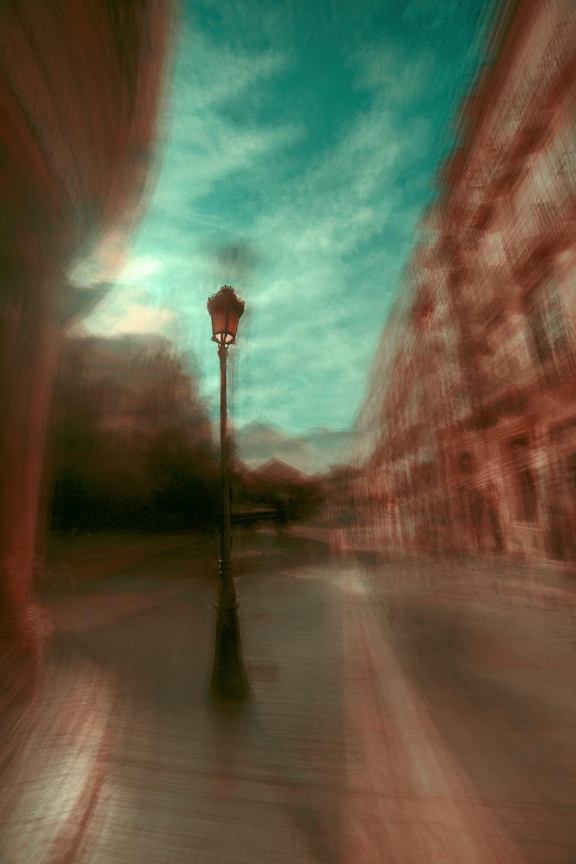 black street post lamp beside wall