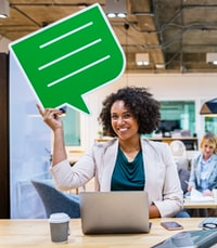 woman sitting holding green dialogue box