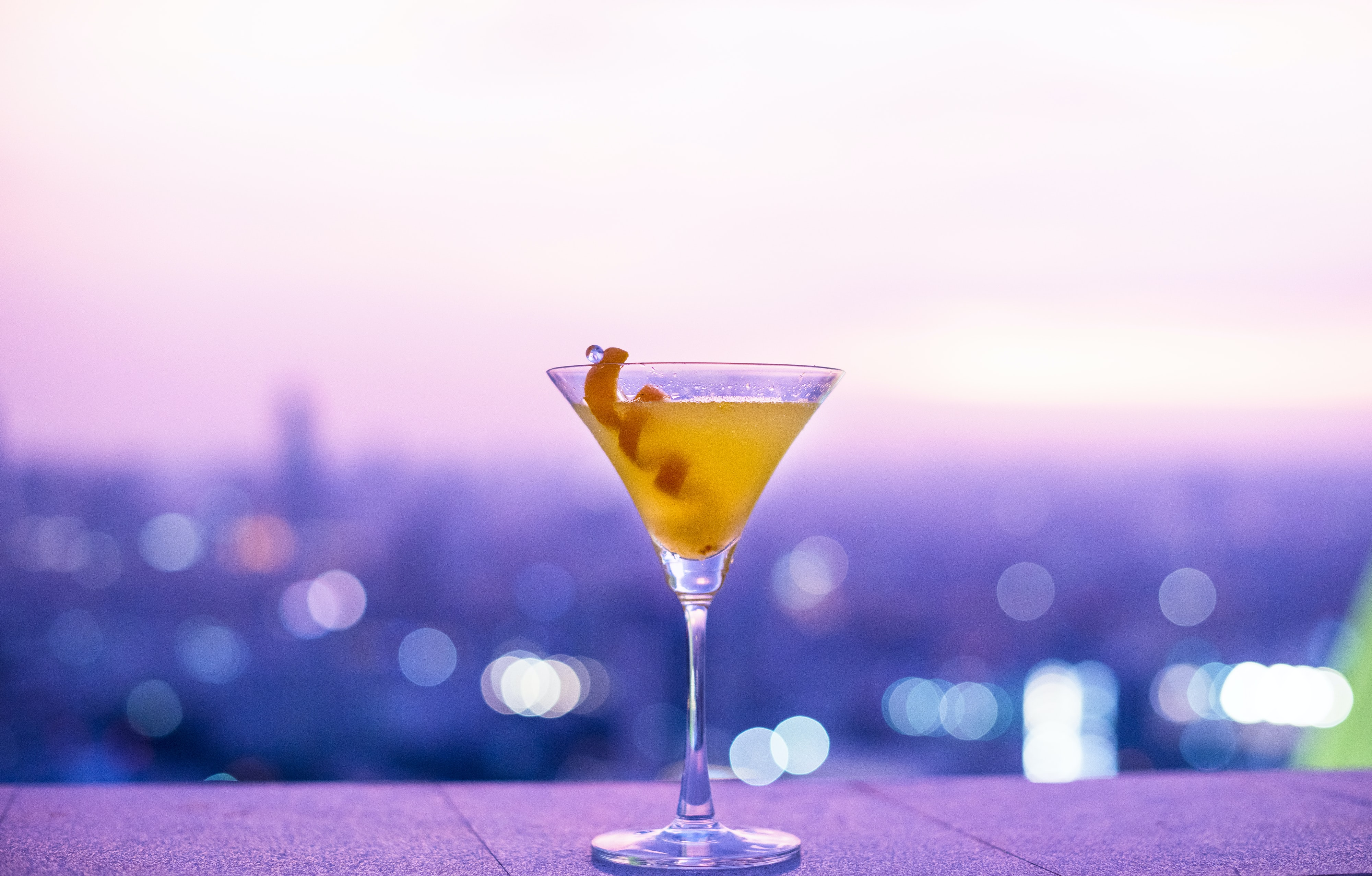 clear martini glass with yellow liquid