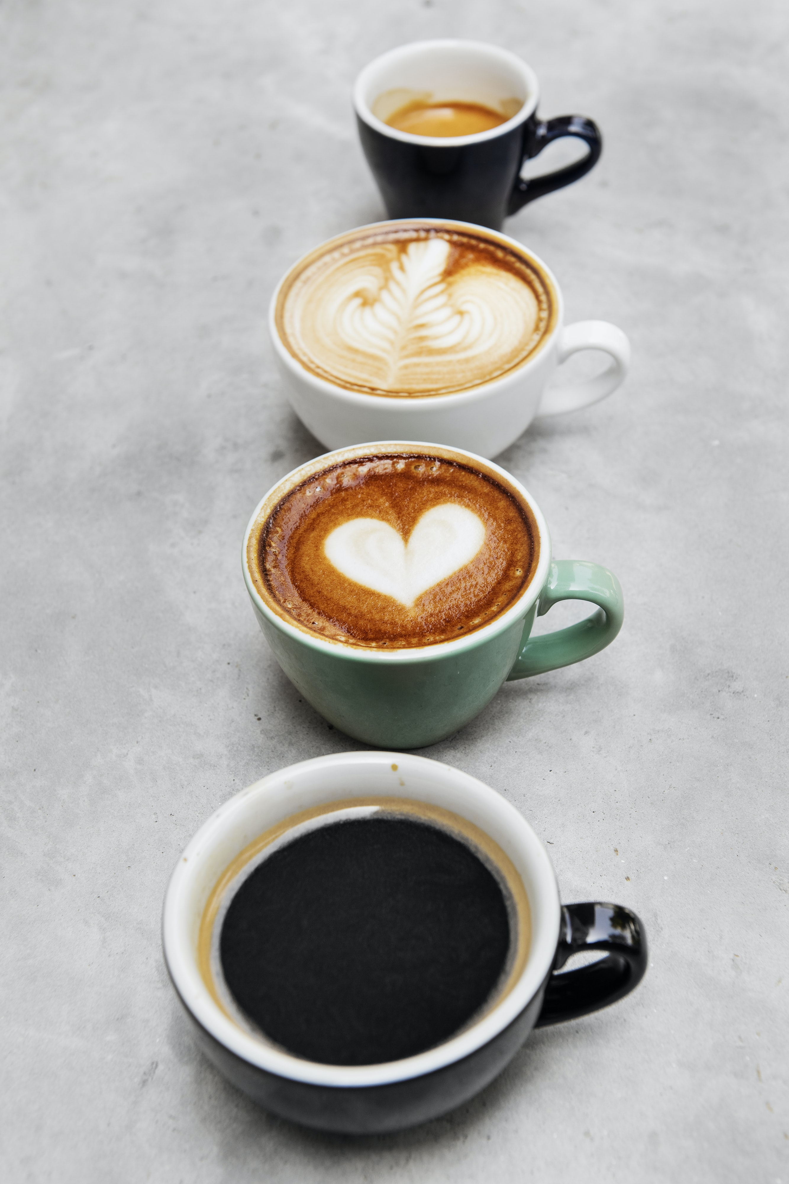four mugs with latte