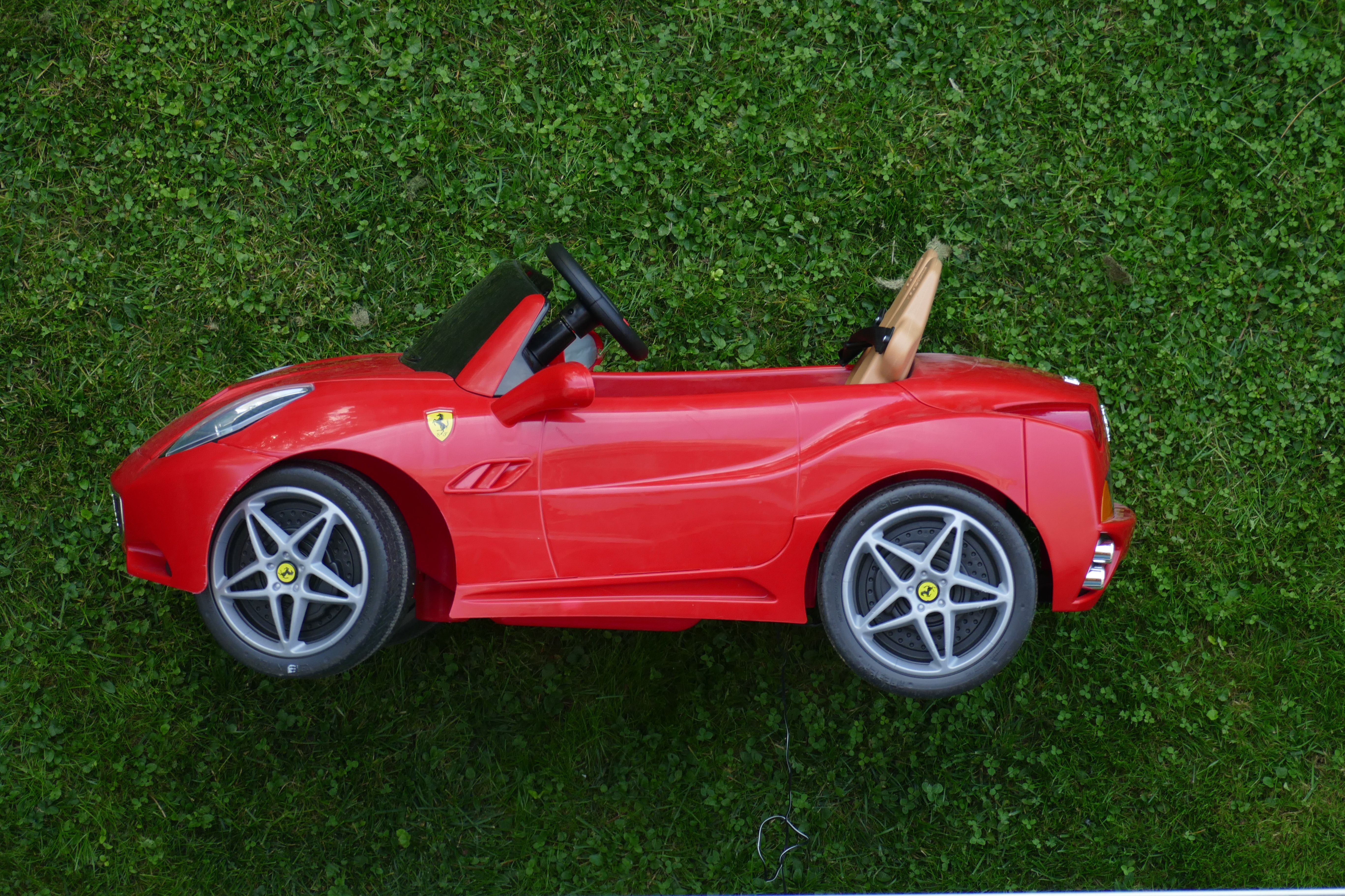 red Ferrari ride-on car toy