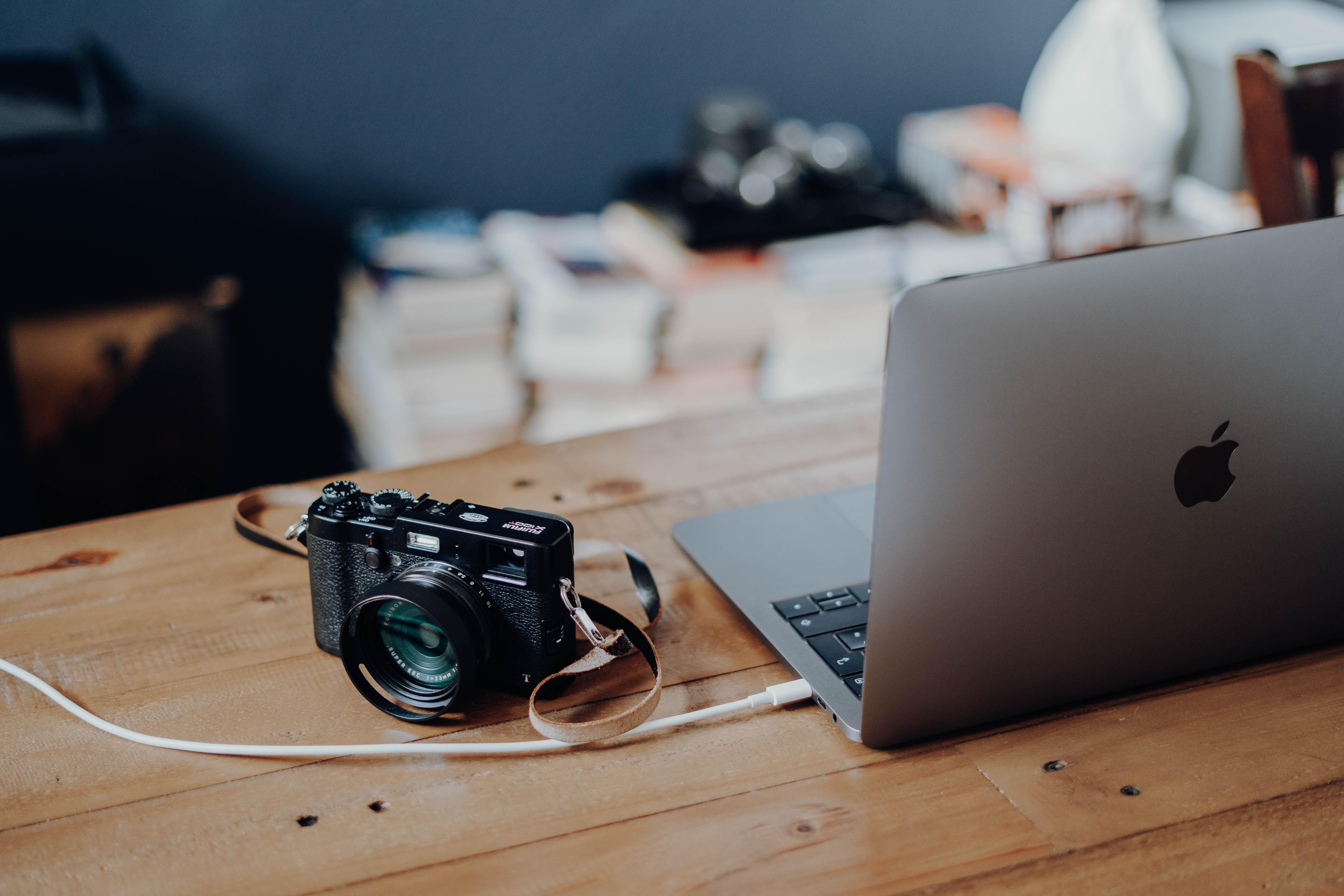 MacBook Air and black SLR camera