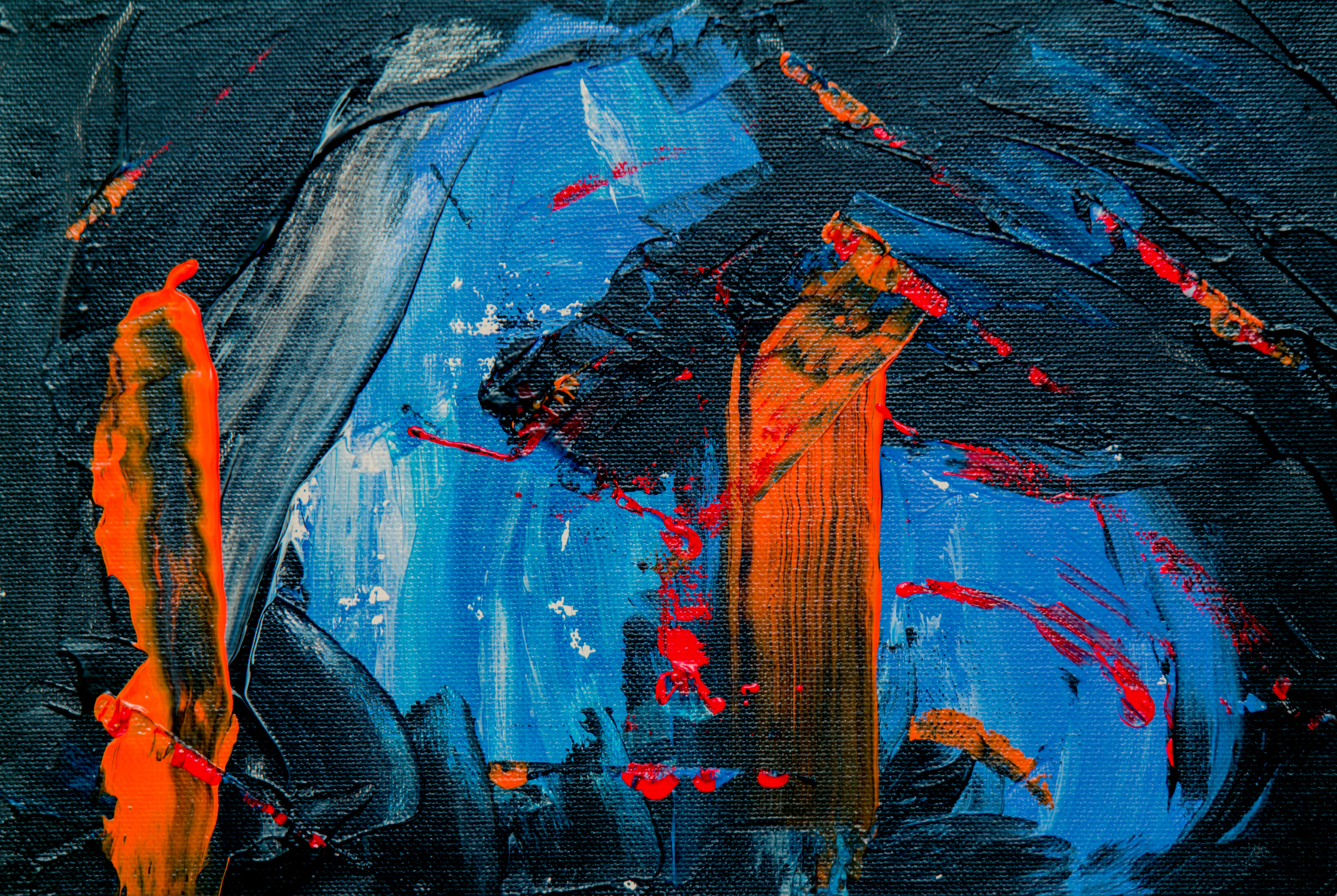 blue, black, and orange abstract painting