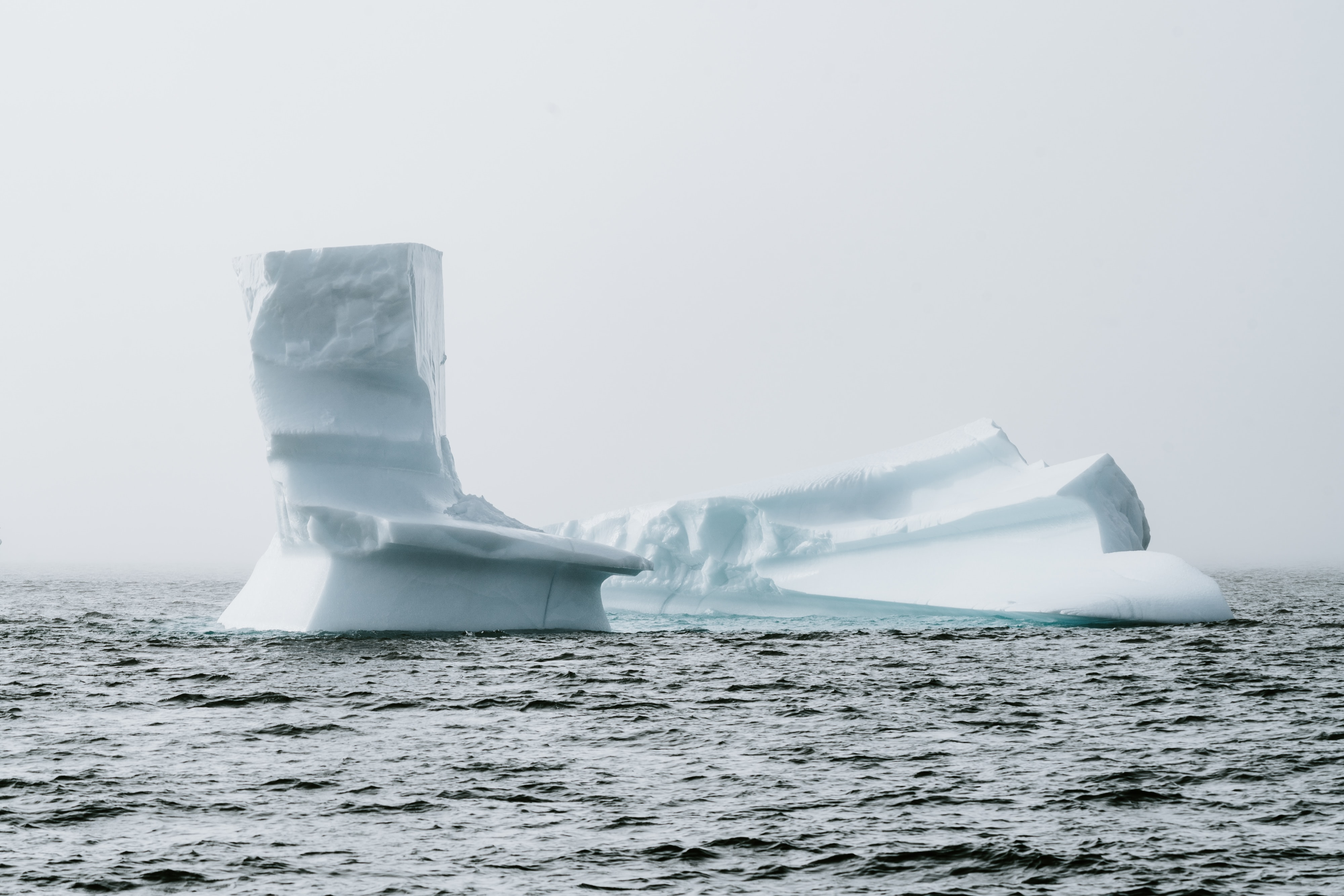 iceberg surrounded by body of water