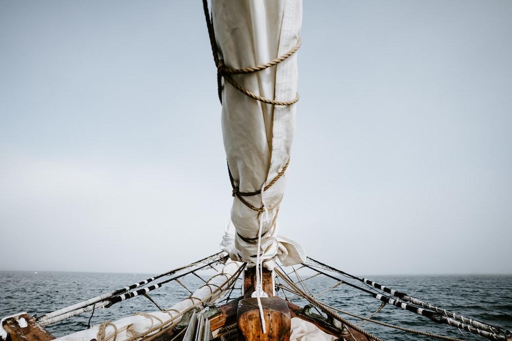 boat on sea under white sky