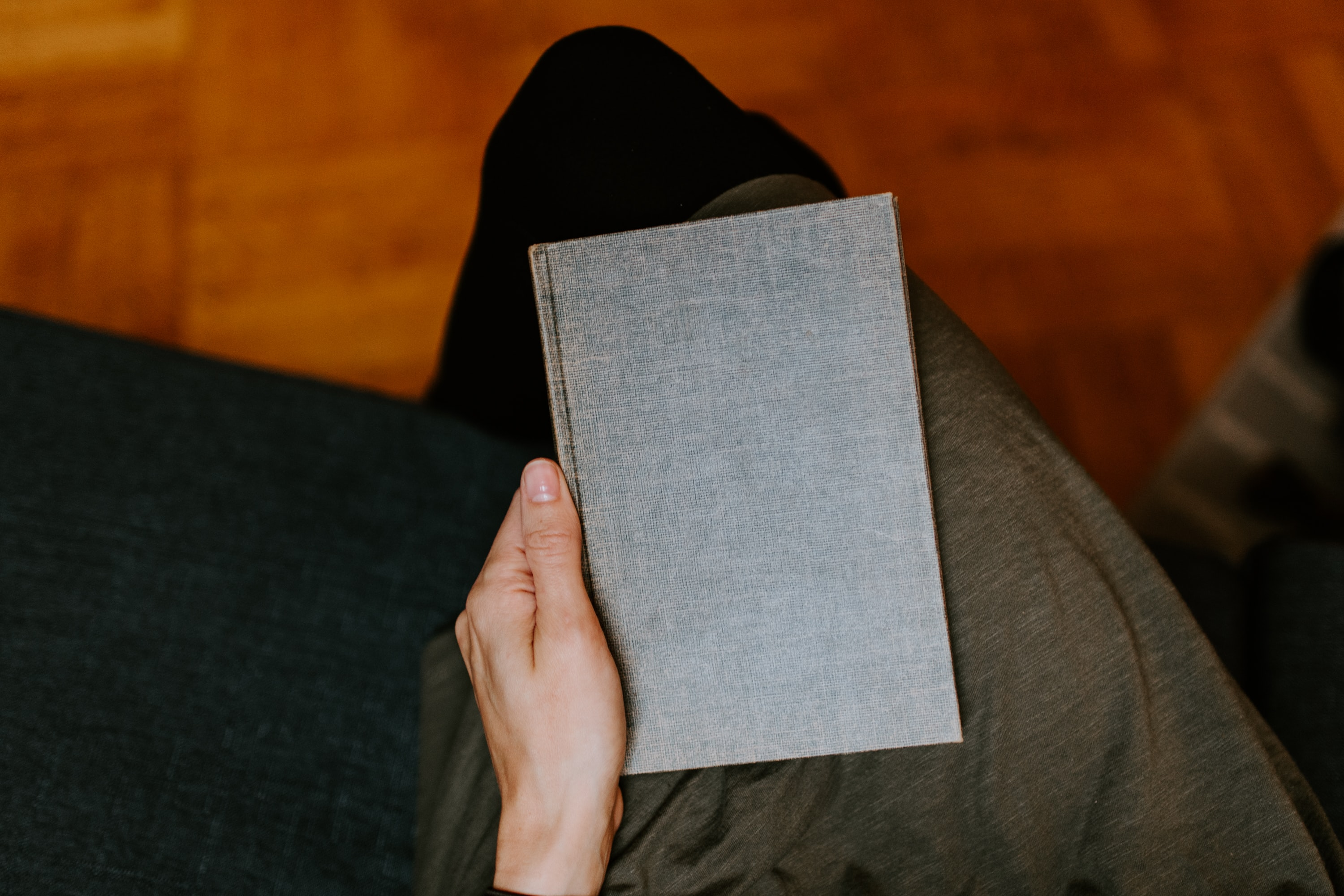 person holding gray book