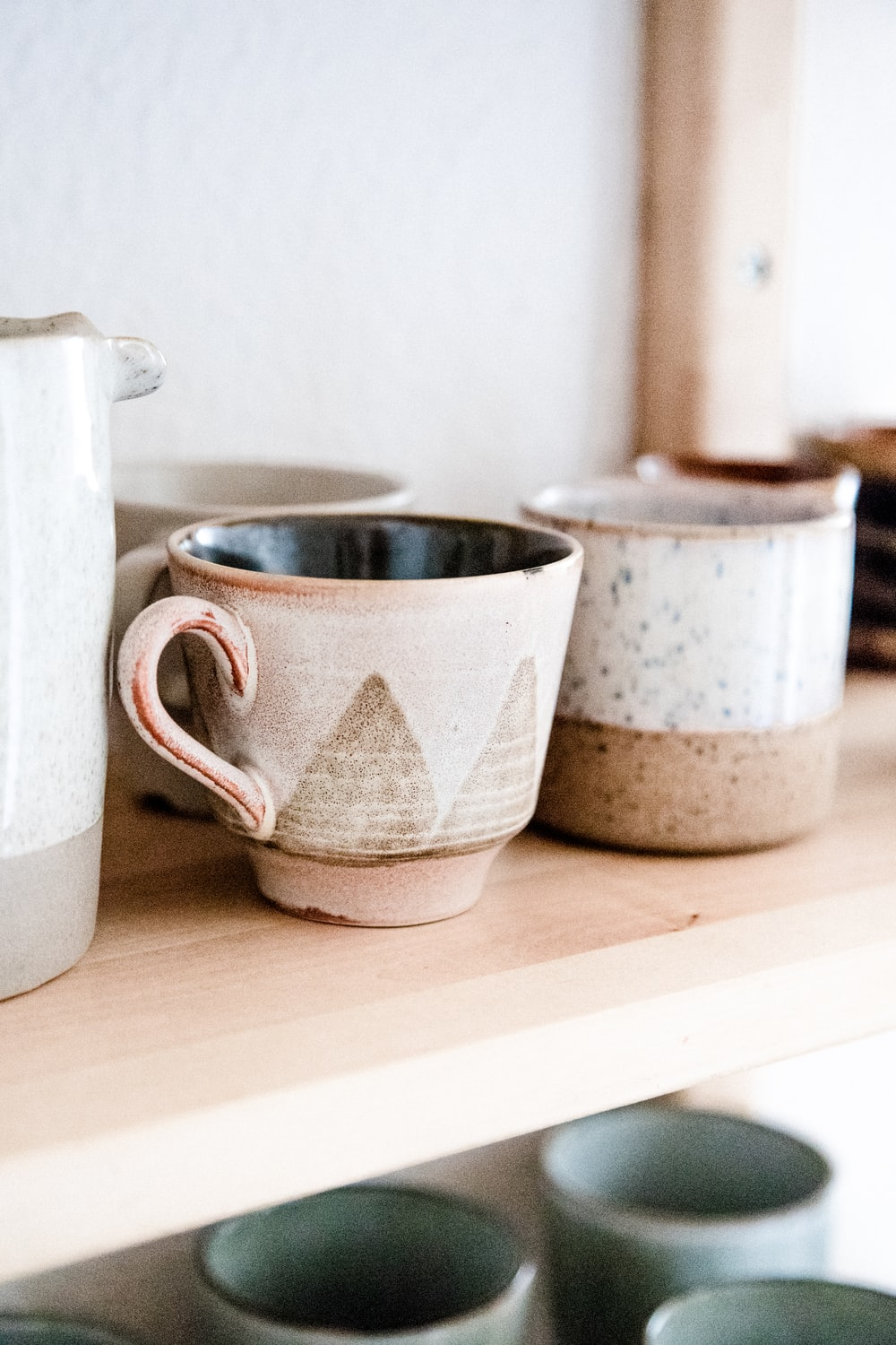 two white ceramic mug