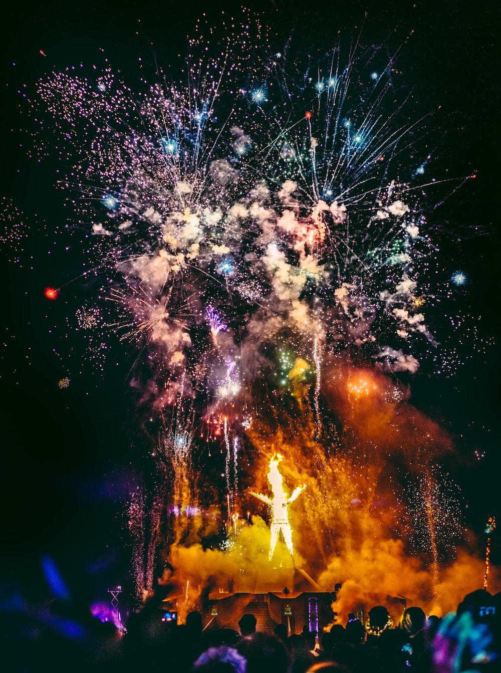 crowd of people watching fireworks display
