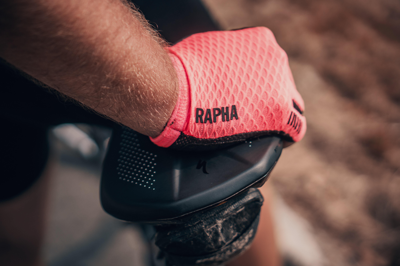 person wearing pink Rapha gloves