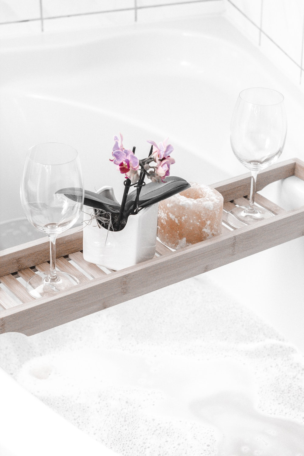 two wine glasses on tray