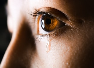 close-up photo of human eye with tear drops
