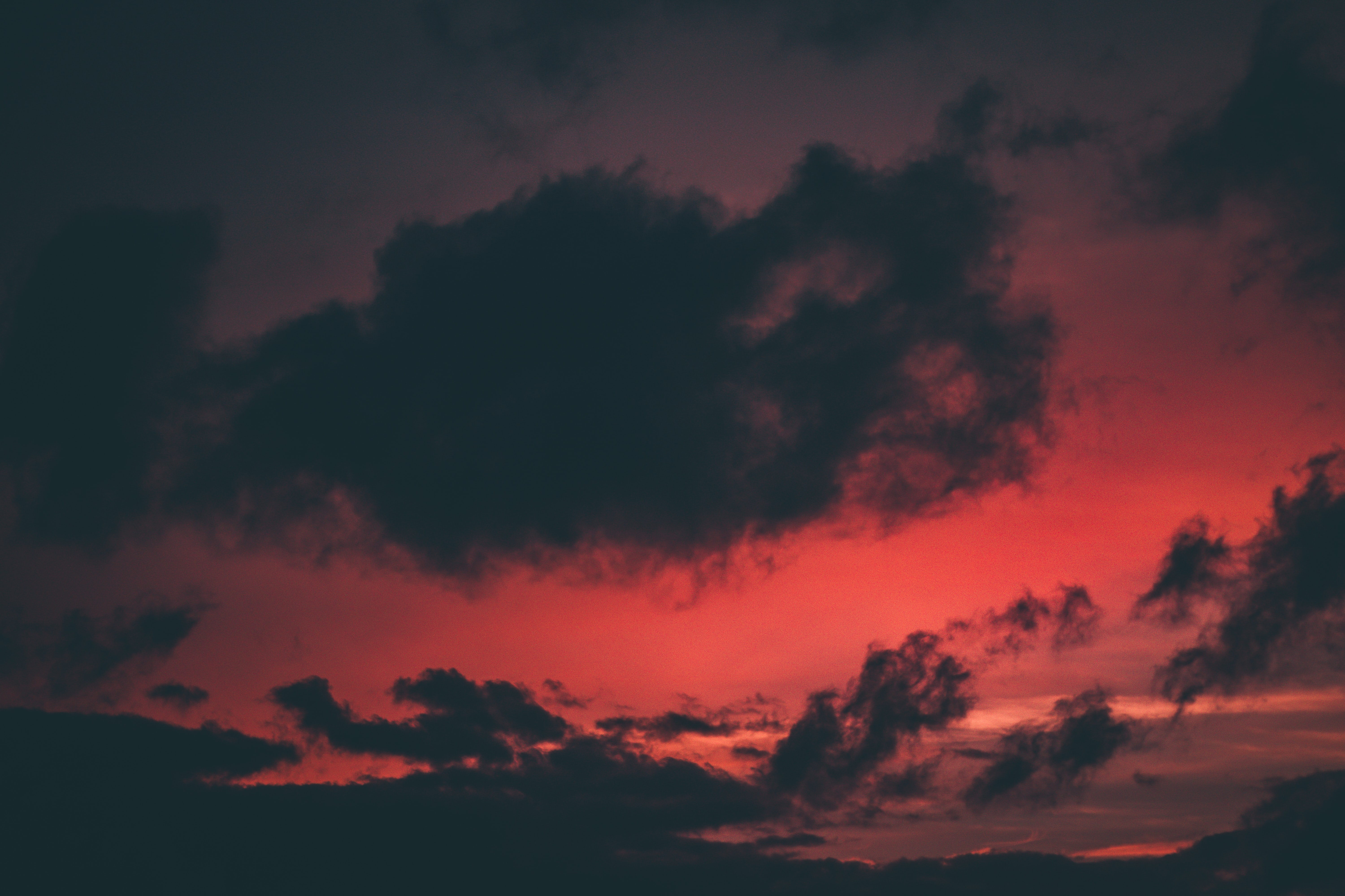 selective focus photo of red sky and gray clouds