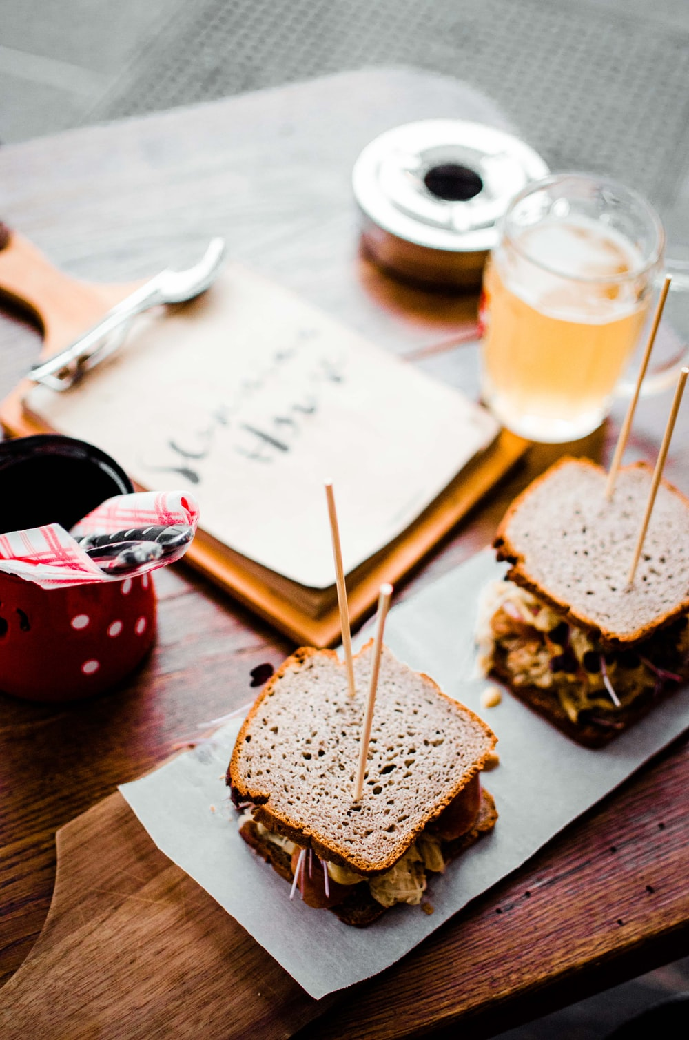 sandwich beside glass cup photo