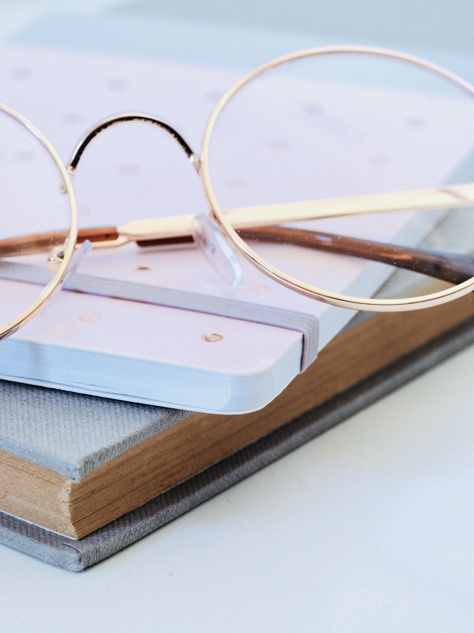 eyeglasses on book