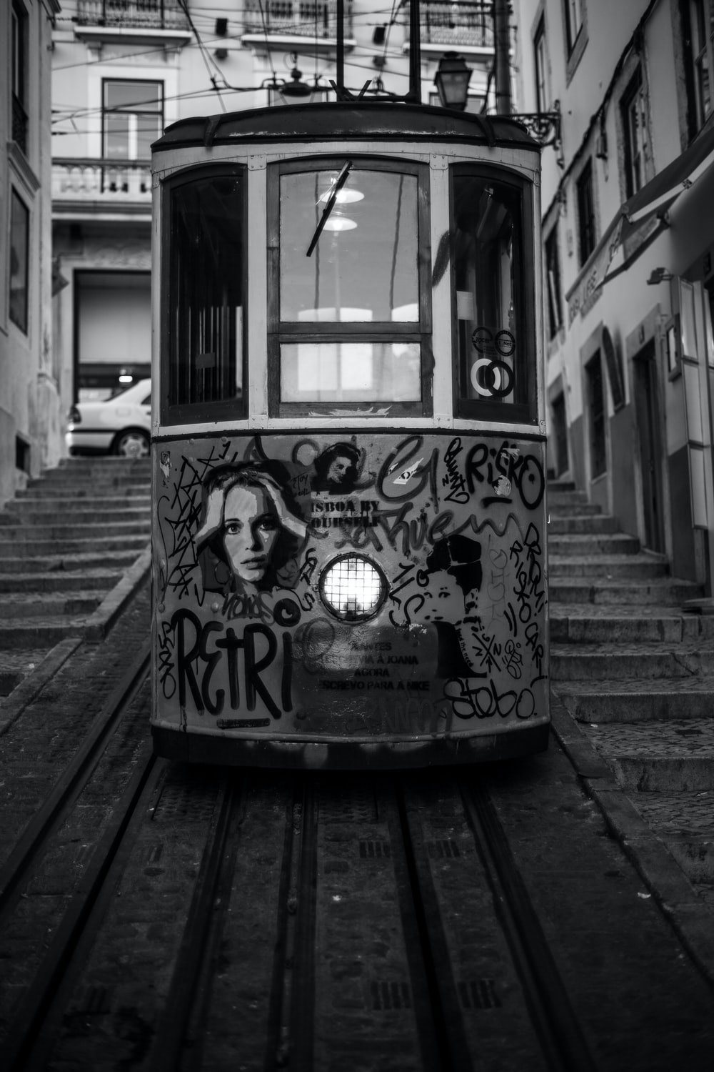 grayscale photo of a cable car with print