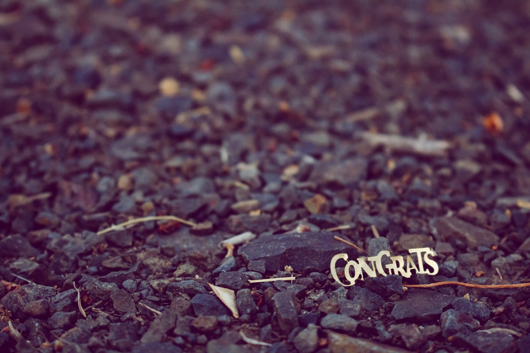 """This fallen, forgotten piece of gold confetti from some graduation party at the beginning of summer is still lingering in the gravel on the side of the road, wishing everyone who walks by the teensiest, tiniest """"congratulations!"""""""