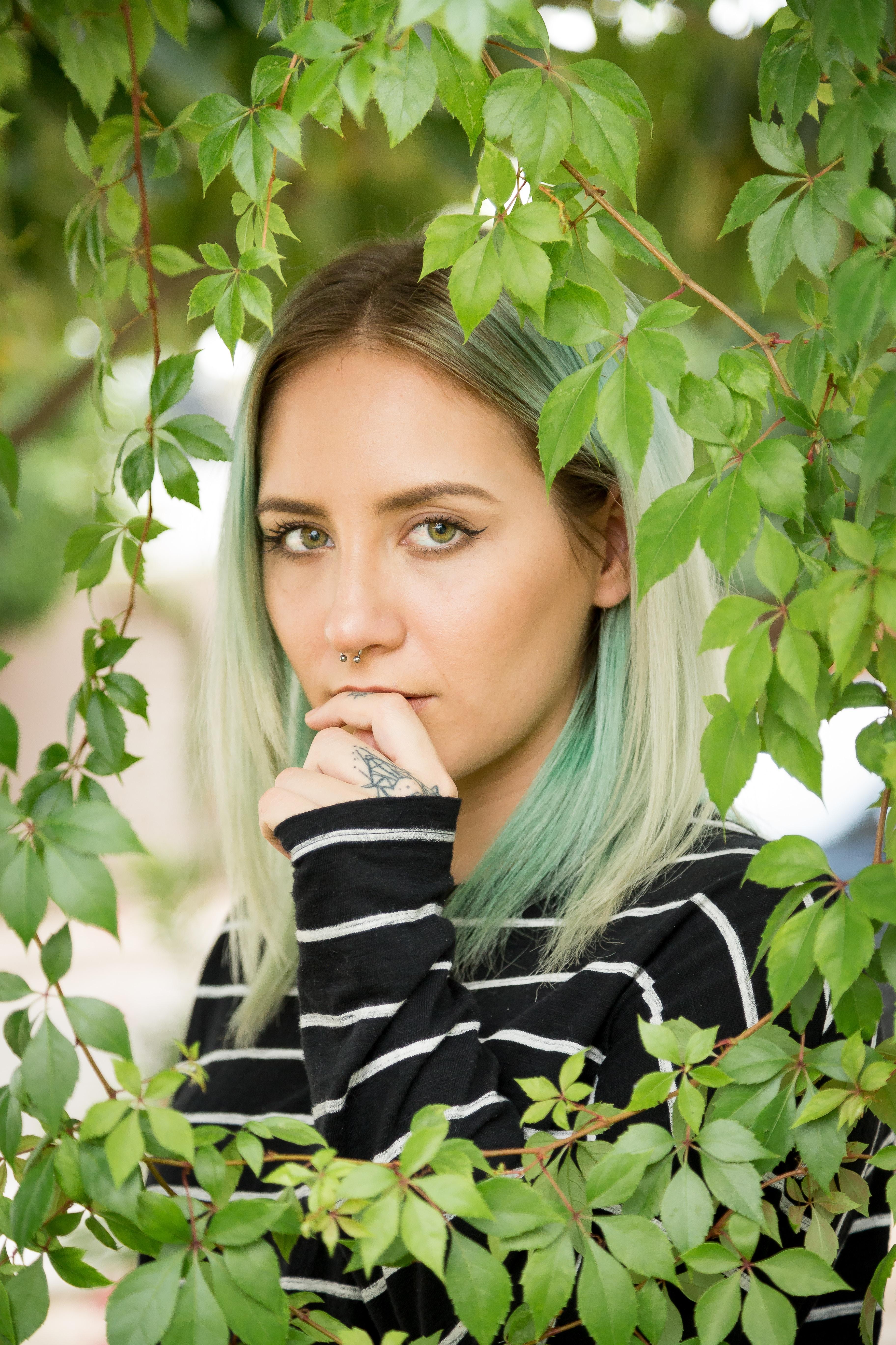 woman standing behind leaves