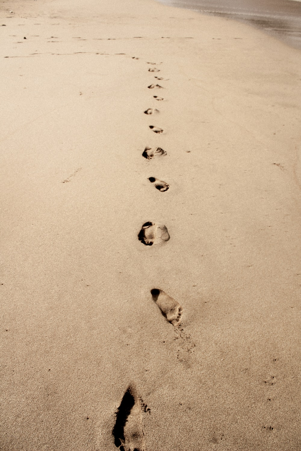 photo of footprints in the sand