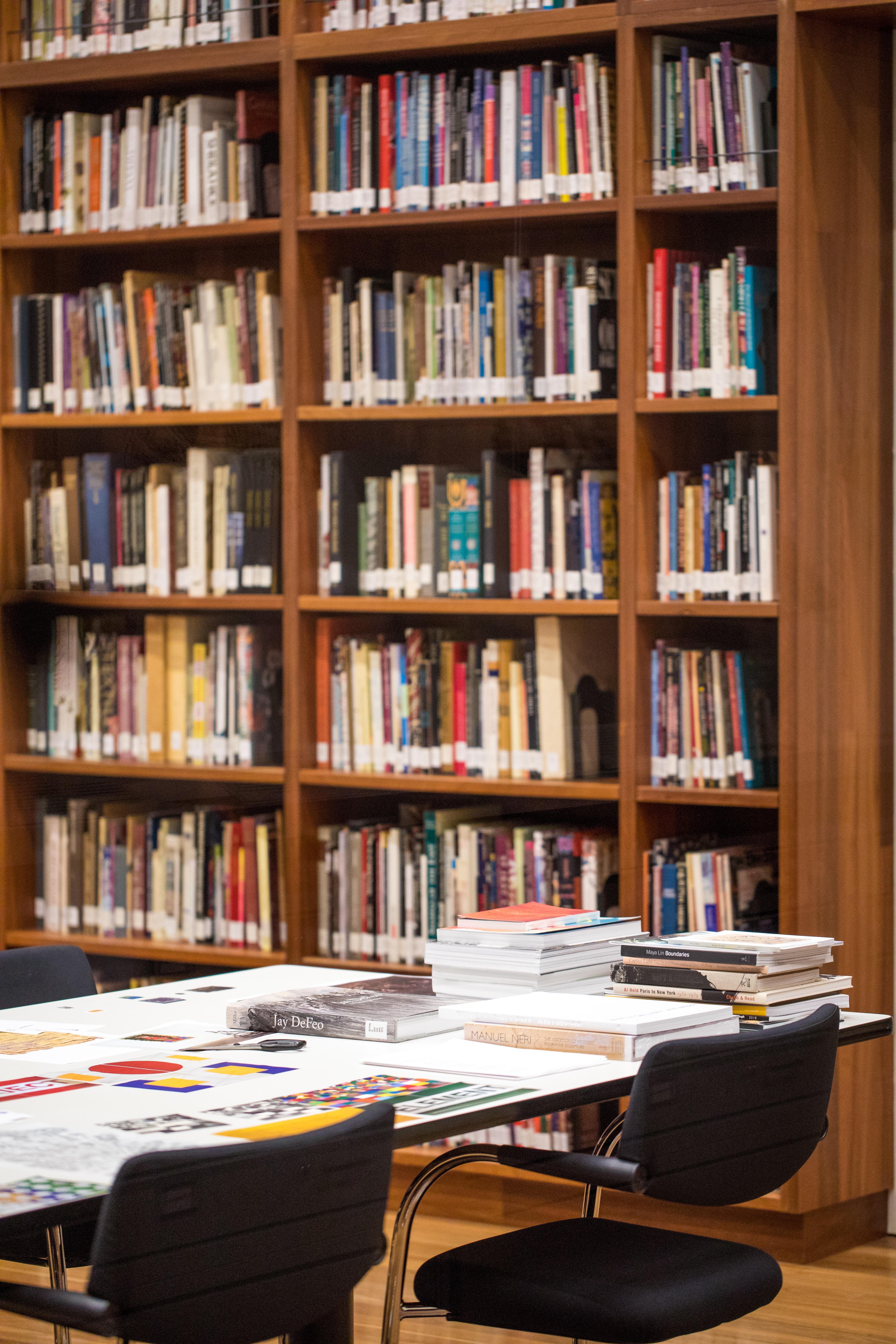 white table near bookshelf