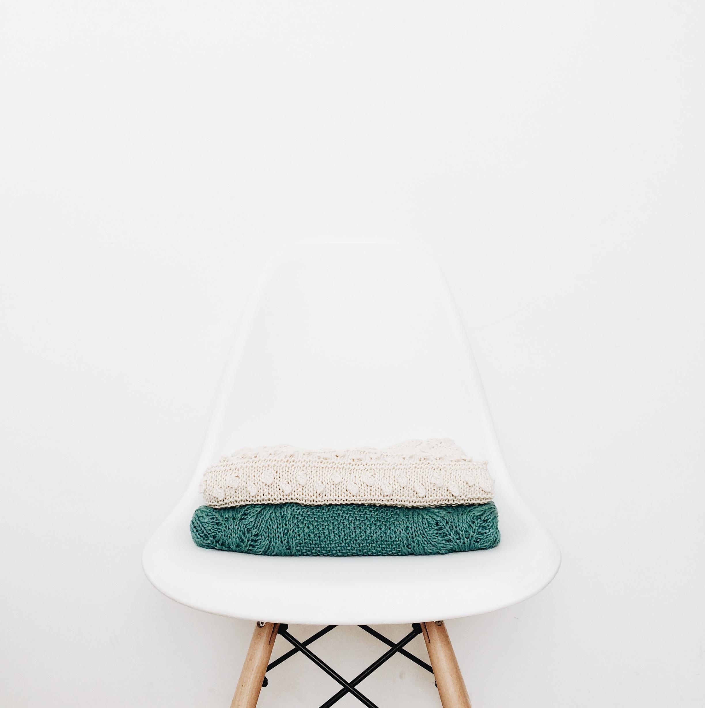 white and teal textile on white stool