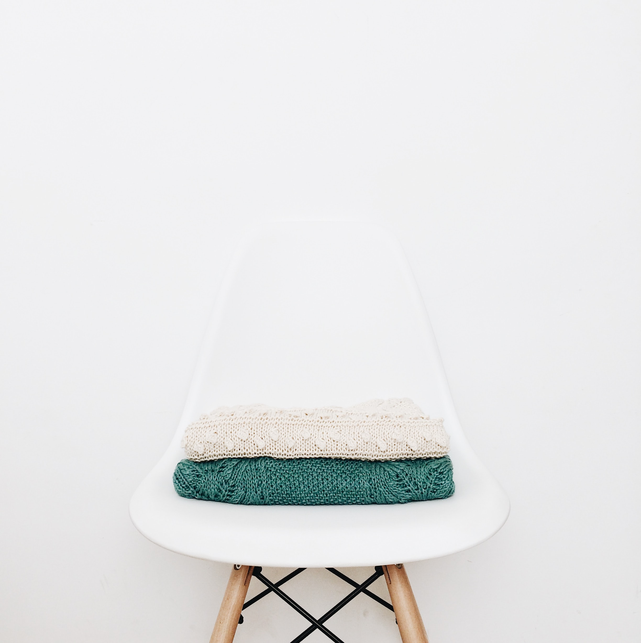 white and teal textile on white stool