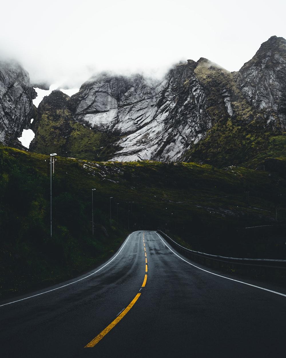 a mountain road photo by taneli lahtinen tanelah on unsplash