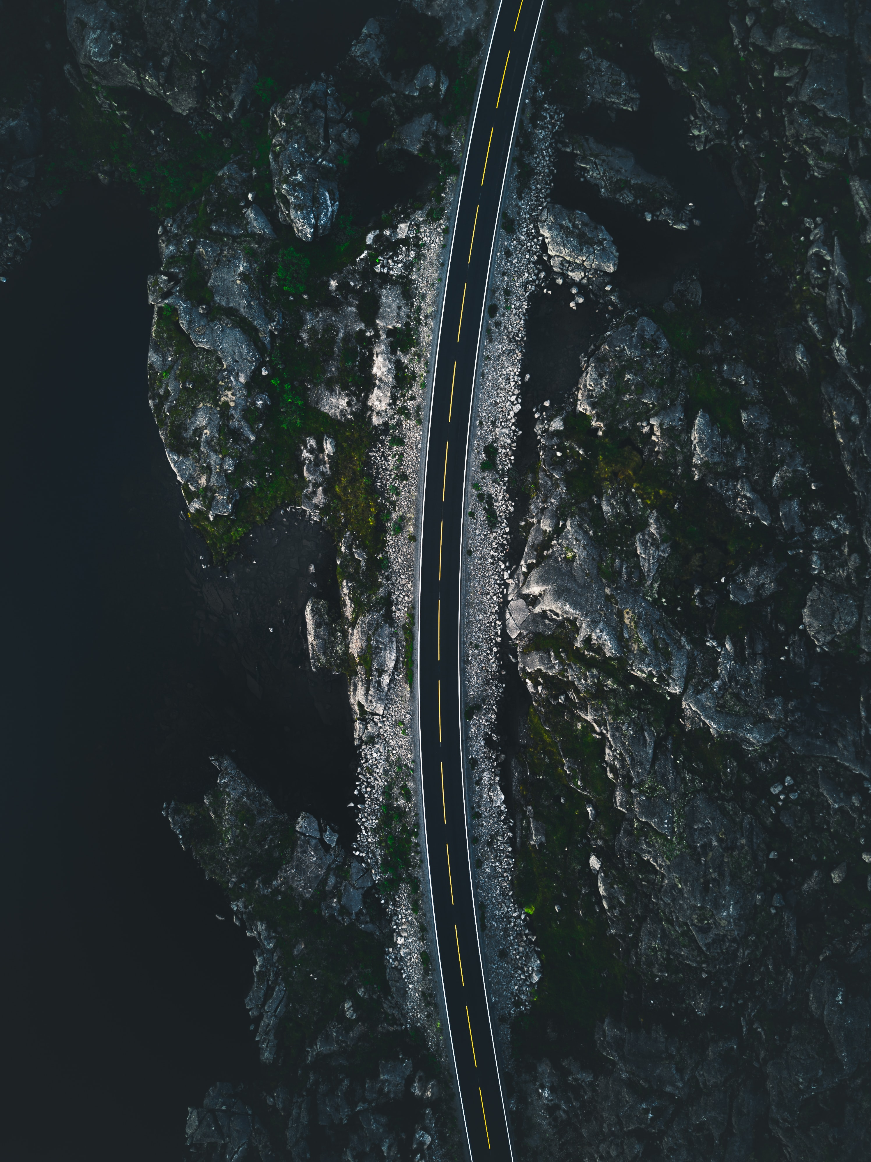 aerial view photography of concrete road near cliff