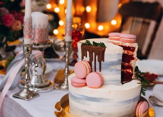 2-tier cake on table beside candles