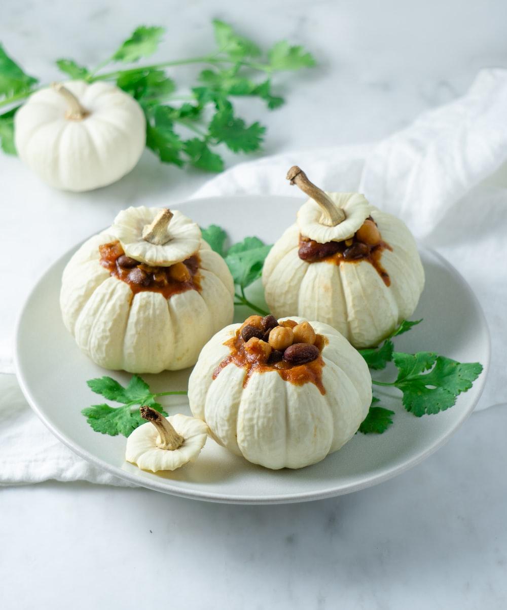 white ceramic plate with garlics