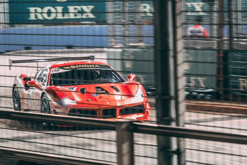 red Ferrari luxury car traveling on road