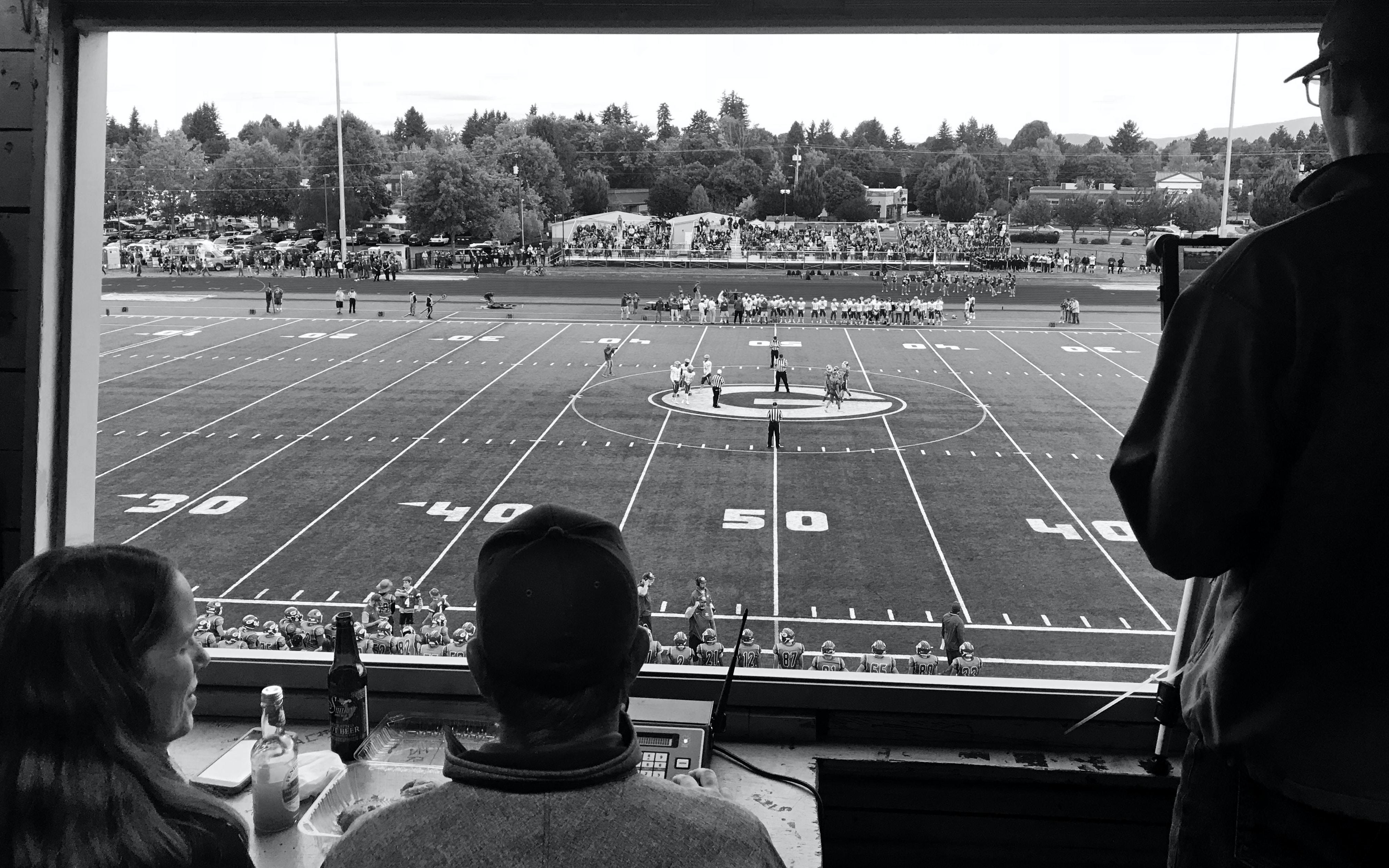 greyscale photo of football play