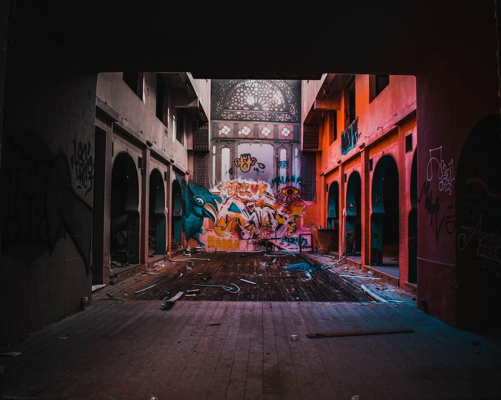 mural on wall beside arch hallway
