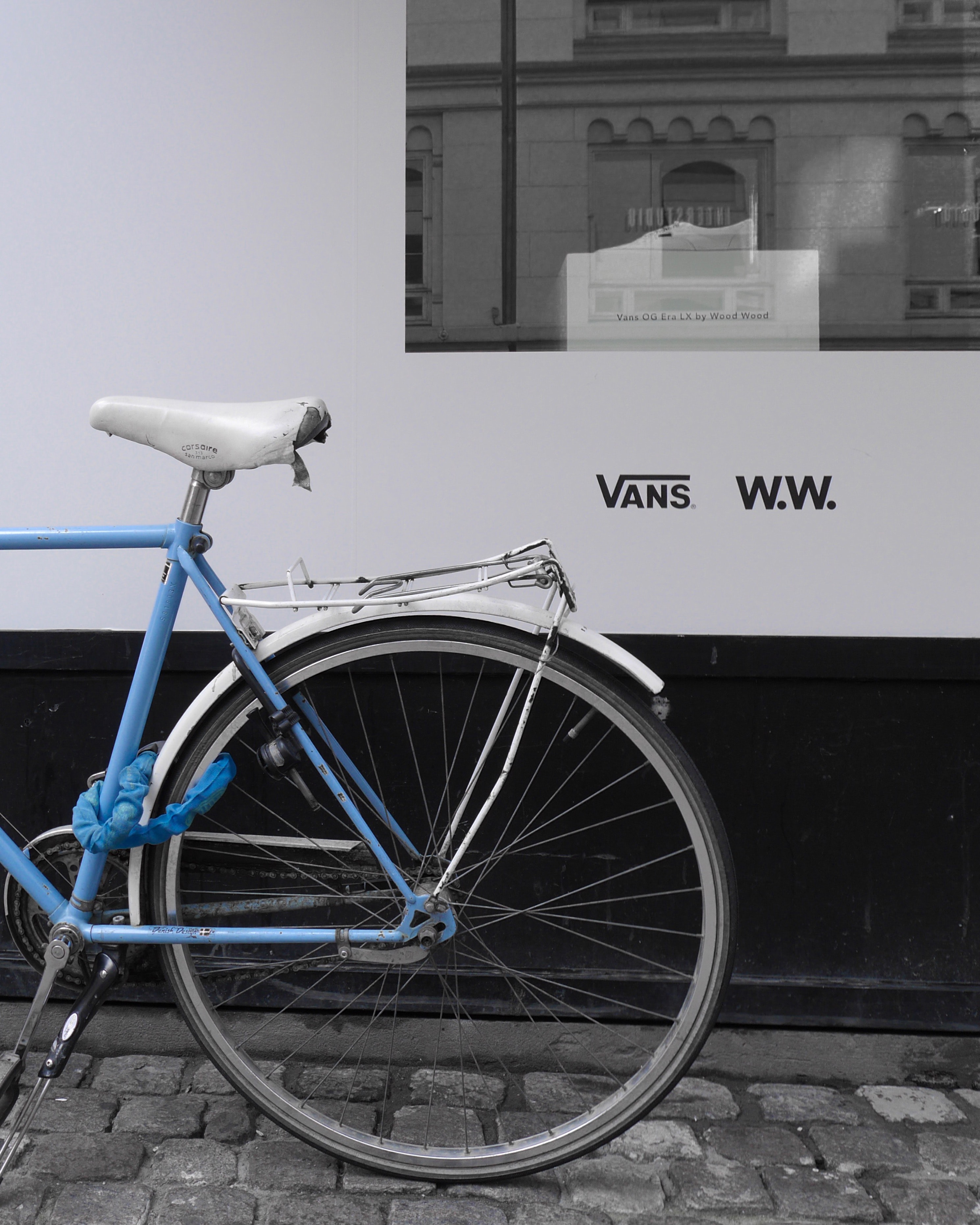blue cruiser bicycle in front of window