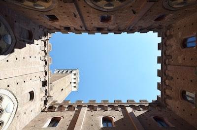 brown castle building center court under clear blue sky