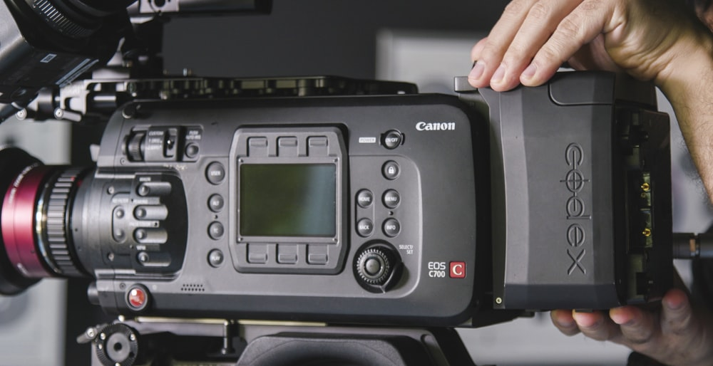 person using Canon Codex video camera